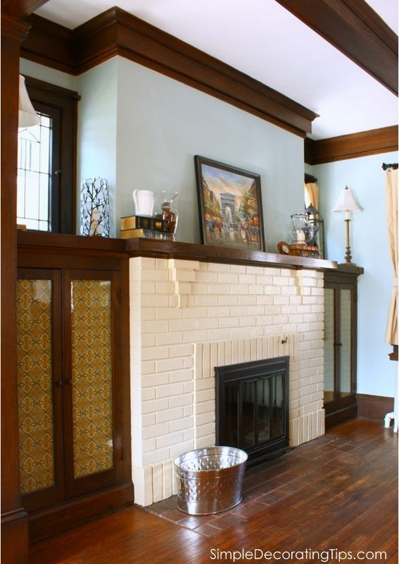 drastically change a fireplace with a little paint and fabric SimpleDecoratingTips.com