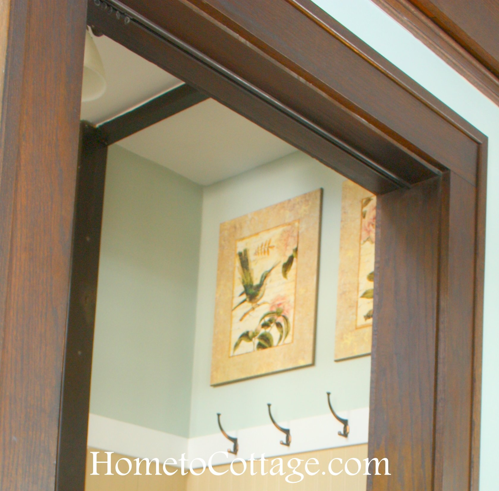 HometoCottage.com craftsman style house with built in rings for doorway curtain