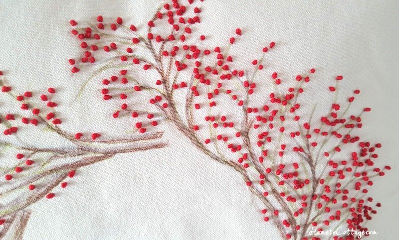 HometoCottage.com french knot red berry wreath pillow up close 1
