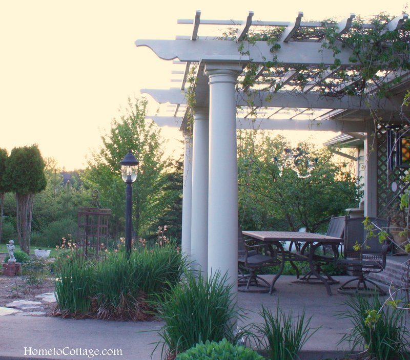 HometoCottage.com pergola from side toward early sunset