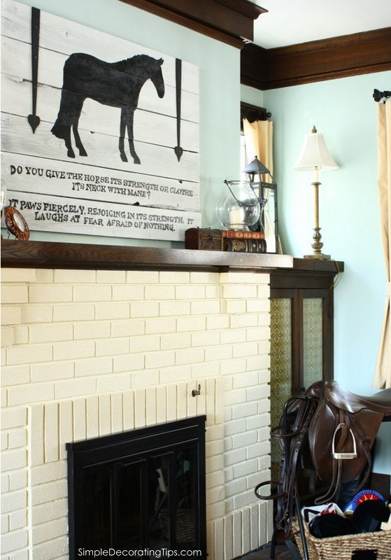 SimpleDecoratingTips.com drastically change a fireplace with a little paint and fabric