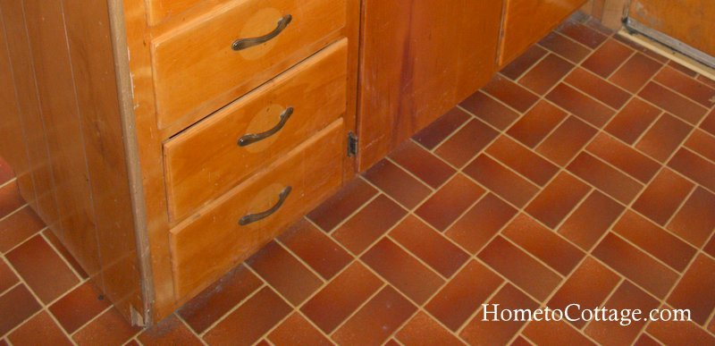 HometoCottage.com brick cottage kitchen floor before